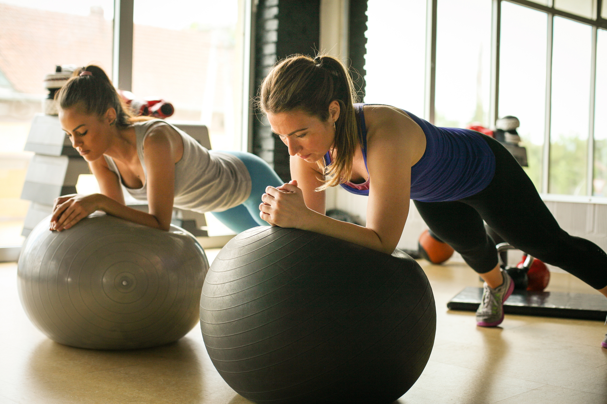 Two Woman doing Stability Ball Exercises