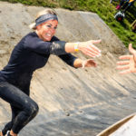 Woman running up quarter pipe