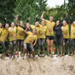 group of colleagues in mud