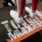 fabletics white trainers on tough mudder obstacle